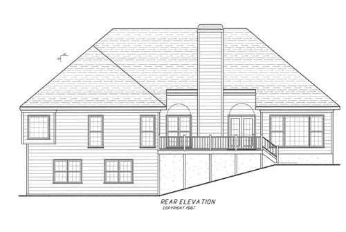 Вид сзади Проект одноэтажного дома с цокольным этажом, террасой и выступающим гаражом