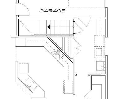 Этот популярный проект одноэтажного дома в английском стиле площадью  до 200 кв.м с гаражом на 2 машины и с 2 спальнями подходит для постоянного проживания. В большой спальне есть ванная. Также сзади дома пристроена веранда..